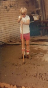 Mark, as a young boy, working and learning the construction business